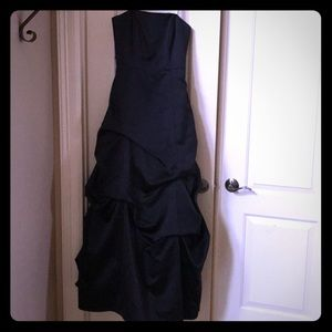 Black strapless evening gown.